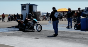 Motorcycle takes a small fall just before starting drag race