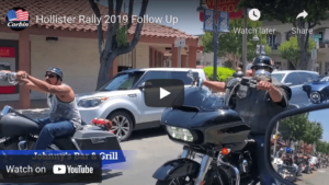 Two motorcyclists riding on San Benito Street during Hollister biker rally